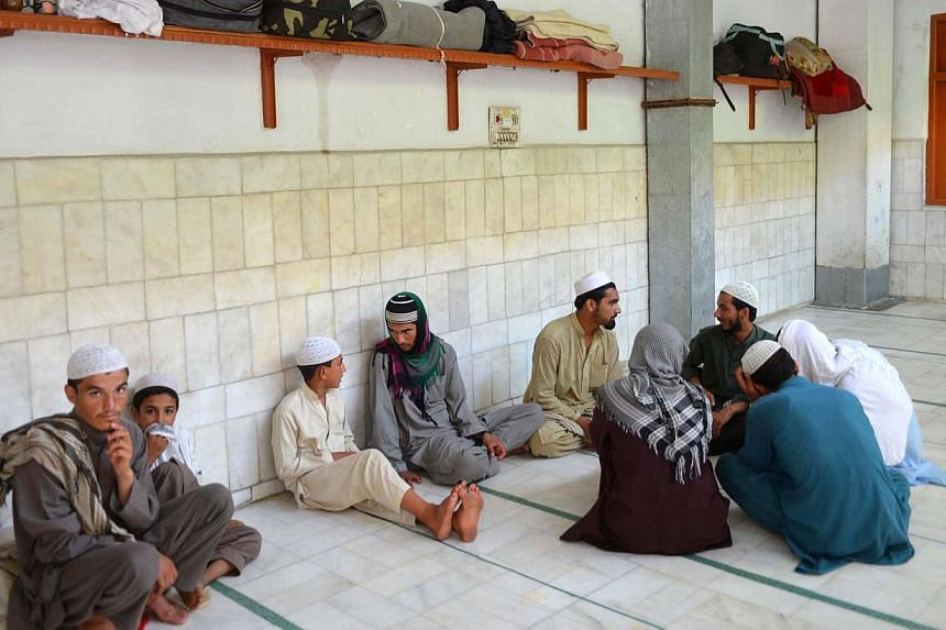 Pakistani religious students at the Ganj Islamic seminary in Peshawar on Aug 21, 2013. A Pakistani madrassa slapped with US sanctions as an alleged terror training centre has denied the charges, insisting it teaches only religion and Arabic grammar t