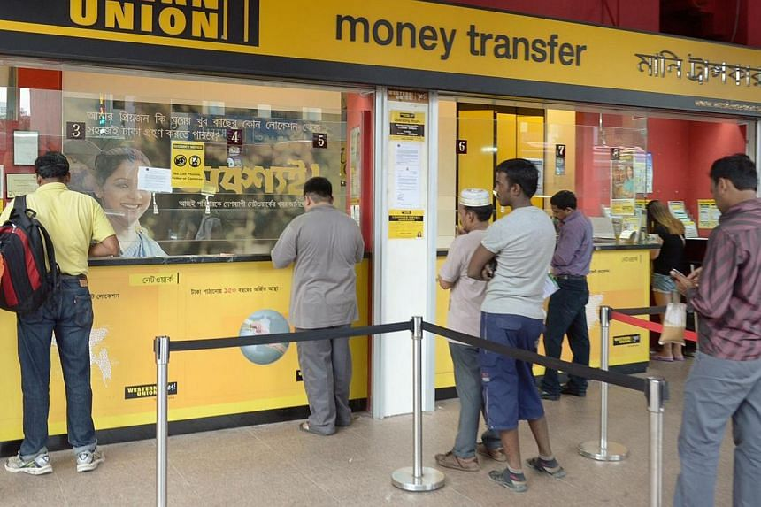 Western Union's Owen Road outlet has been serving about 300 Indian workers daily since Monday, double the usual 150. Indonesian and Indian workers said they wanted to take advantage of favourable exchange rates to send money home, while others are