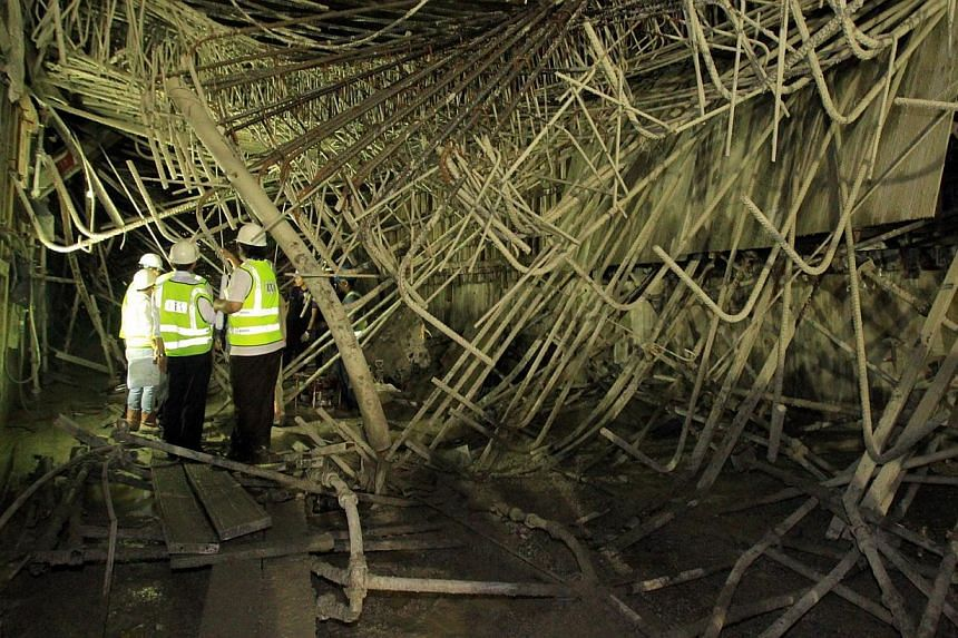 In July last year, two workers were killed and eight hurt when a roof being cast at the Downtown Line's Bugis interchange collapsed. -- LIANHE ZAOBAO FILE PHOTO