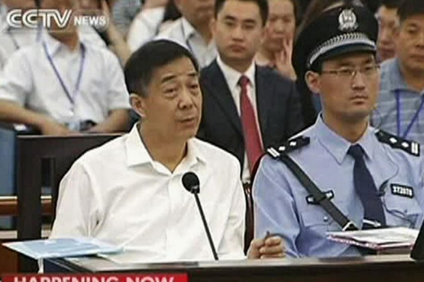 Disgraced Chinese politician Bo Xilai speaks during a court hearing in Jinan, Shandong province on Aug 22, 2013 in this still image taken from video. Bo denied one of the bribery charges against him on Thursday as he appeared in public for the first