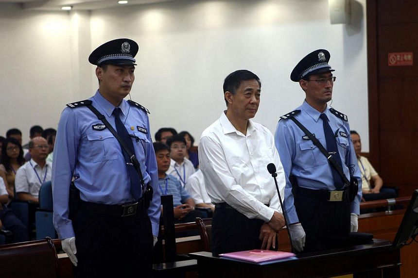 Disgraced Chinese politician Bo Xilai stands trial inside the court in Jinan, Shandong province on Aug 22, 2013, in this photo released by Jinan Intermediate People's Court. Fallen Chinese politician Bo appeared in public for the first time in more t