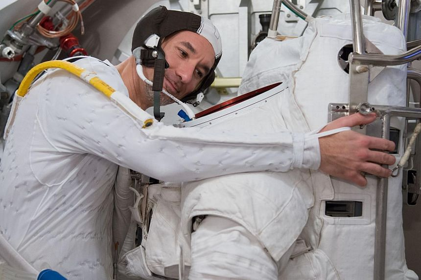In this March 4, 2013 photo made available by Nasa, European Space Agency astronaut Luca Parmitano participates in an Extravehicular Mobility Unit (EMU) spacesuit fit check in the Space Station Airlock Test Article (SSATA) of the Crew Systems Laborat