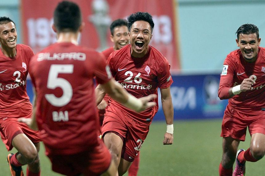 The LionsXII celebrate Shahfiq Ghani's (centre) goal in their Malaysia Cup home match against Kedah at Jalan Besar Stadium on Tuesday, Aug 20, 2013. A complimentary shuttle service has been launched for the rest of the team's Malaysia Cup home matche