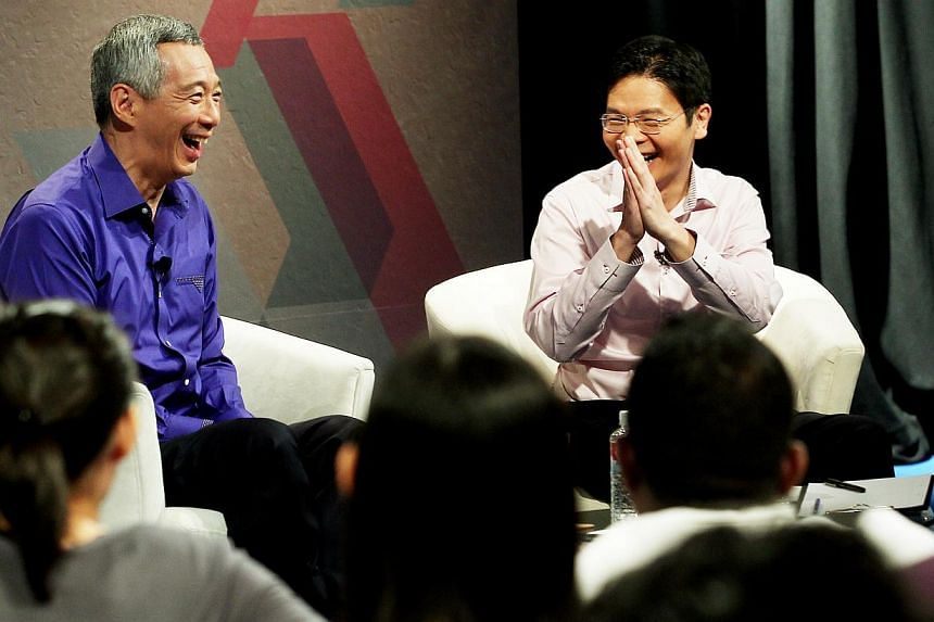 PM Lee Hsien Loong and Acting Minister for Culture, Community and Youth Lawrence Wong at a dialogue with 60 youth leaders last night. Mr Lee told the audience there are limits to how widely, and for how long, his Government can consult the public bef
