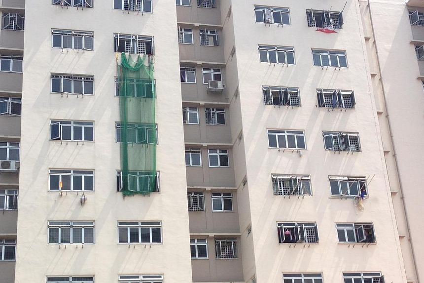 A net was also hung from a unit on the eight floor of the block by Singapore Civil Defence Force (SCDF)officers, purportedly to prevent anyone from jumping out of the windows in the units below.-- ST PHOTO:BRYNA SINGH