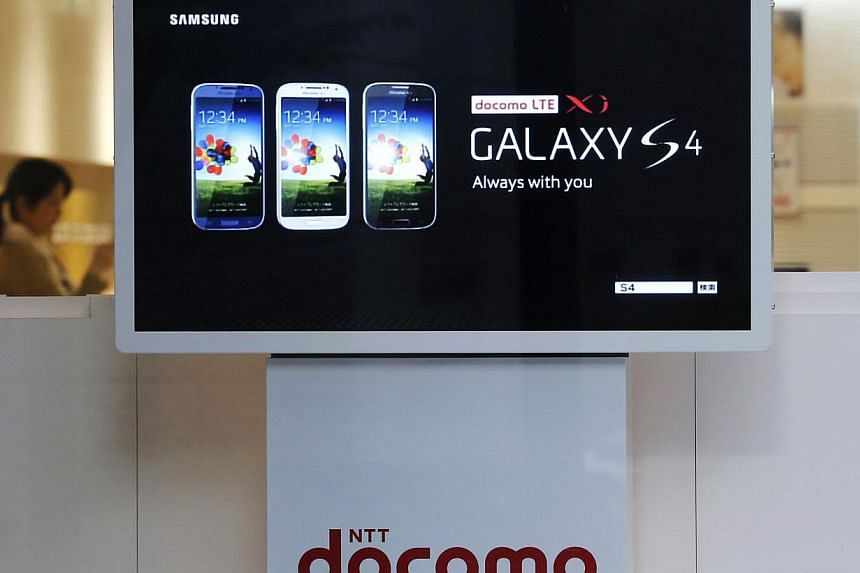An advertisement of Samsung Electronics Co's Galaxy S4 smartphone is displayed at a shop of Japan's biggest mobile phone operator NTT Docomo in Tokyo on July 3, 2013. But Samsung laptops and TVs are not sold in the country. -- PHOTO: REUTERS