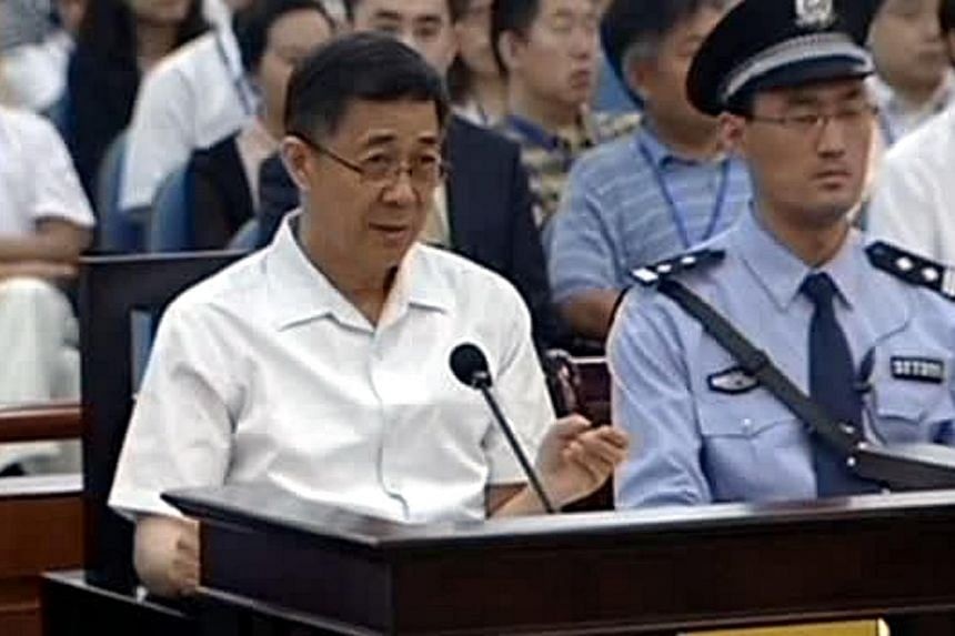Bo Xilai (left), the former Communist Party chief of the south-western city of Chongqing, speaks during his trial in Jinan, Shandong province, August 23, 2013, in this still image taken from China Central Television (CCTV). -- PHOTO: REUTERS