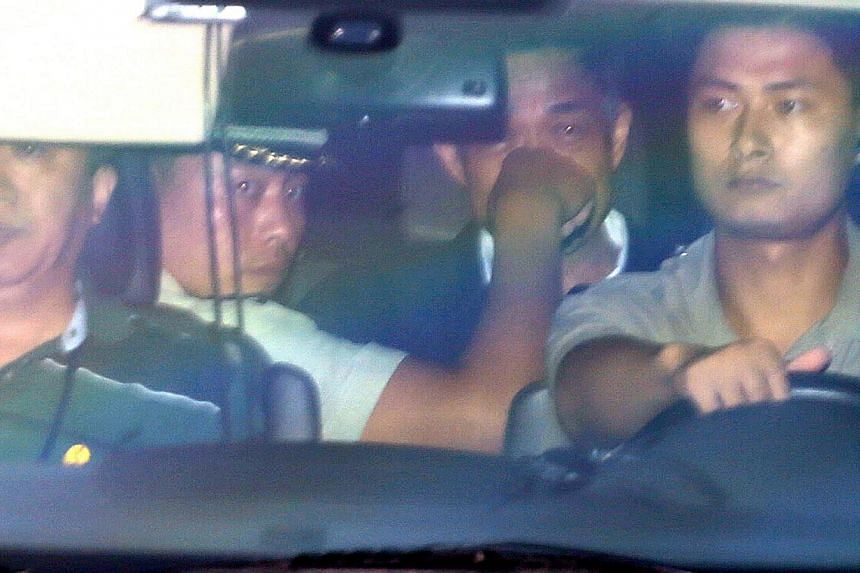 Bo Xilai (centre, face obscured), former Communist Party chief of the south-western city of Chongqing, leaves the Jinan Intermediate People's Court building in a vehicle in Jinan, Shandong province on Aug 23, 2013.-- PHOTO: REUTERS
