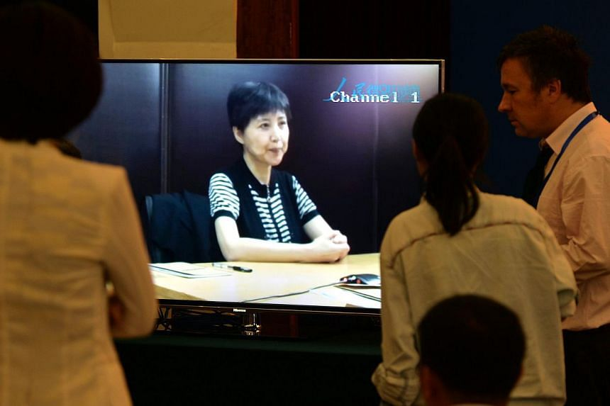Gu Kailai (centre), the wife of disgraced politician Bo Xilai gives a recorded testimony during his trial at the Intermediate People's Court in Jinan, Shandong Province on August 23, 2013. -- PHOTO: AFP