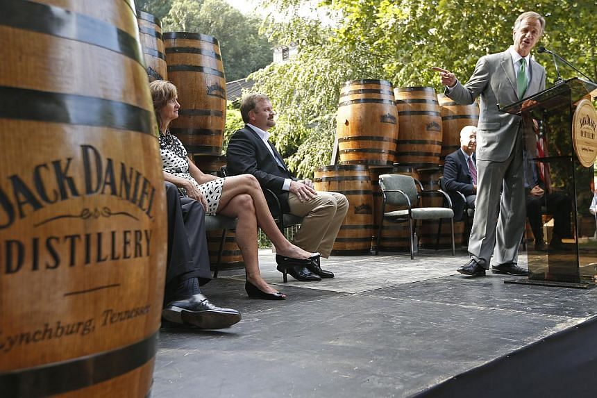 In this photo provided by the State of Tennessee, Governor Bill Haslam, right, speaks at the Jack Daniel Distillery in Lynchburg, Tennessee on Thursday, Aug 22, 2013. The makers of Jack Daniel's whiskey will spend more than US$100 million (S$127.7 mi