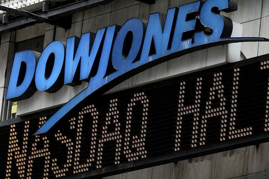An electronic display in Times Square displays news about the Nasdaq in New York, on Thursday, Aug 22, 2013. -- PHOTO : AP
