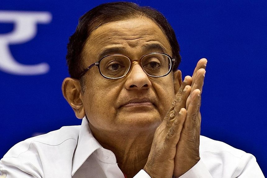 India's rupee recovered against the dollar in early trade on Friday, with investors reassured by comments from Finance Minister P. Chidambaram and the central bank which lifted the currency off its historic lows, analysts said. -- FILE PHOTO: AFP