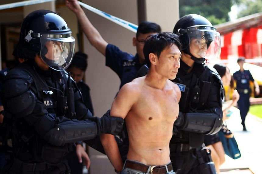 A man involved in a long stand-off with the police in Chai Chee on Friday, Aug 23, 2013, was detained after almost five hours.The tense situation came to an end at about 3.30pm, when the man - who was barefoot, shirtless and wearing jeans - was