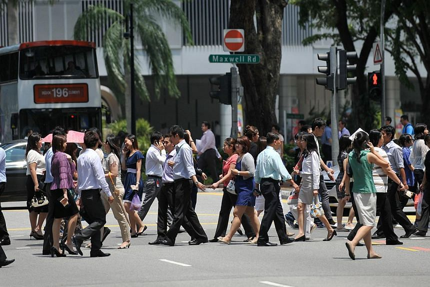Office workers crossing Maxwell Road in the central business district (CBD) area. Many people grumble about their jobs but it seems most Singapore employees are satisfied with their lot and will probably stick with their employer for a few more years