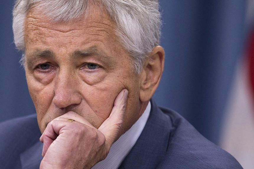 Defence Secretary Chuck Hagel pauses during a news conference at the Pentagon in Washington on July 31, 2013. Hagel strongly suggested the United States was positioning naval forces and assets in anticipation of any decision by President Barack Obama