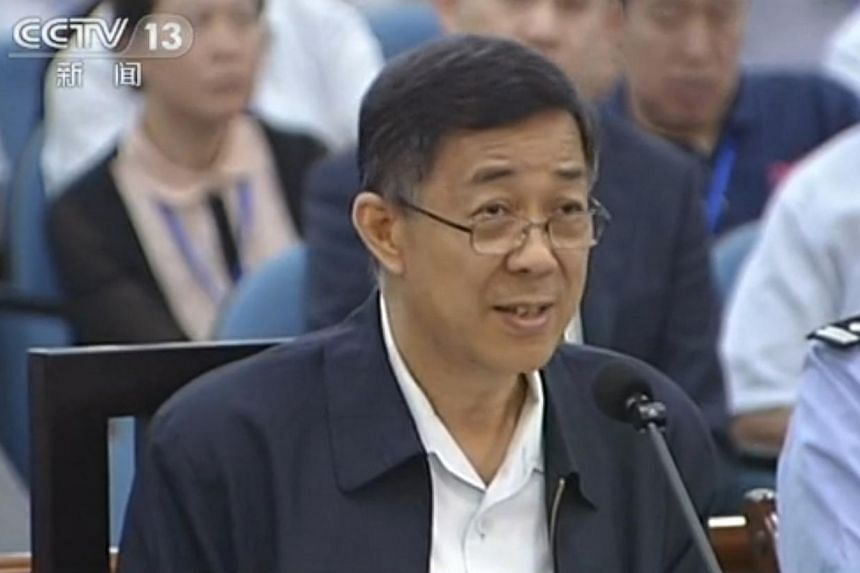 This screen grab taken from state television CCTV footage broadcast on Aug 24, 2013 shows ousted Chinese political star Bo Xilai (centre) speaking in the courtroom as he stands trial at the Intermediate People's Court in Jinan, in eastern China's Sha
