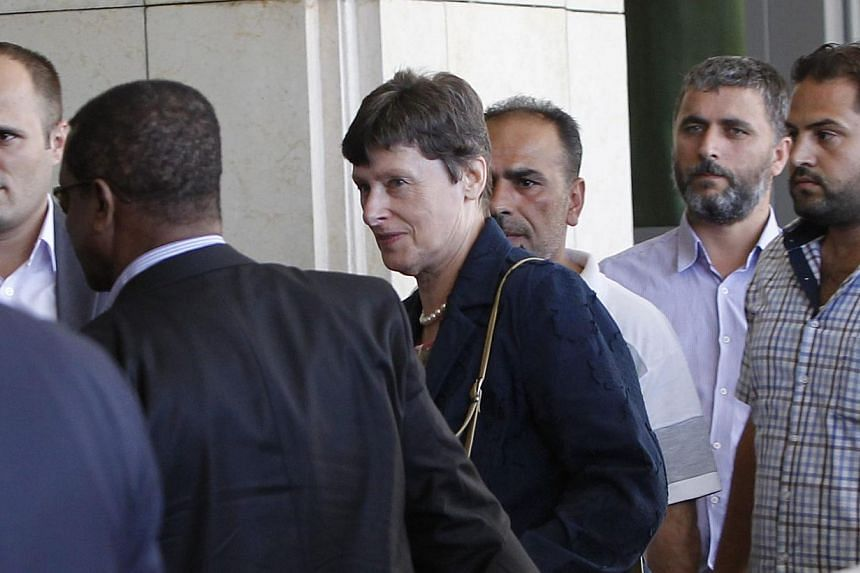 UN Under Secretary General Angela Kane (centre) arrived in Syria's capital on Saturday, Aug 24, 2013, for talks aimed at establishing the terms of an inquiry into alleged chemical weapons attacks, an AFP journalist said. -- PHOTO: REUTERS