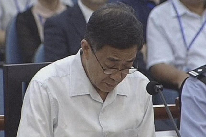 Ousted Chinese politician Bo Xilai sits in court on the third day of his trial in Jinan, Shandong province, in this still image taken from video shot on Saturday, Aug 24, 2013. Bo admitted some responsibility on Saturday for 5 million yuan (S$1.