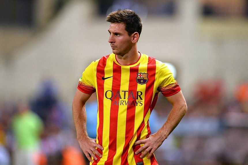 Barcelona forward Lionel Messi during the Spanish Super Cup first leg against Atletico Madrid at Vicente Calderon stadium in Madrid on Wednesday, Aug 21, 2013.Messi will miss Barcelona's trip to Malaga on Sunday due to a thigh injury, the Spani
