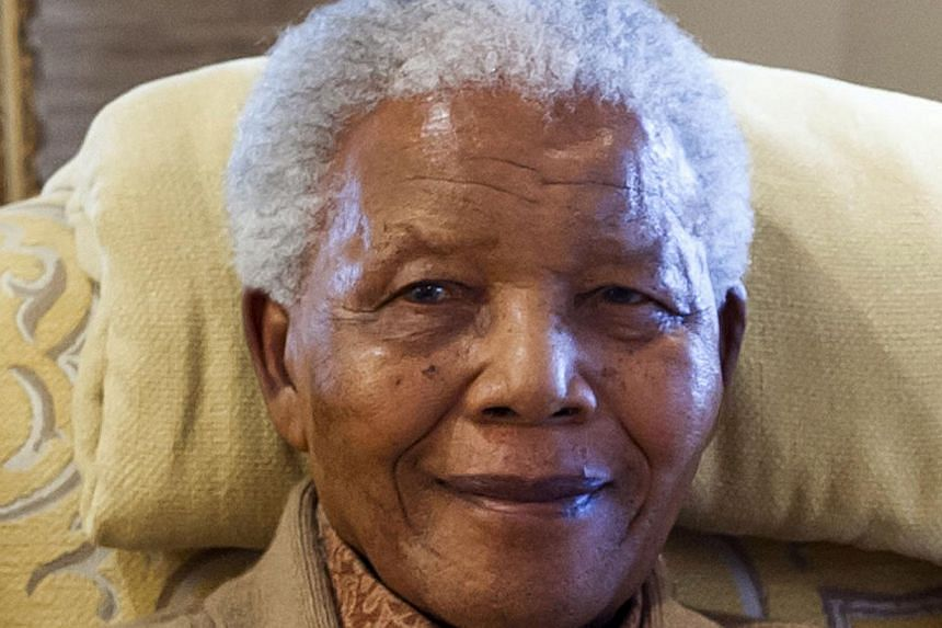"""Mr Nelson Mandela, seen in thisJuly 17, 2012, file photo,is """"unstable"""" at times, but has shown """"great resilience"""" as he remains in a critical condition in hospital, South Africa's presidency said on Saturday, Aug 24, 2013.-- FILE PH"""