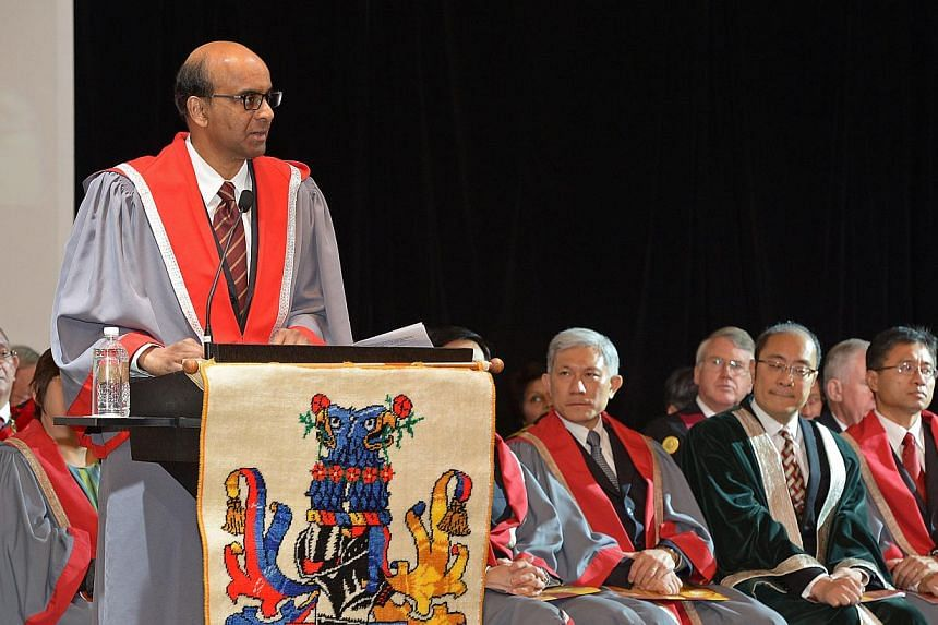 Mr Tharman speaking at the Academy of Medicine, where he was conferred an honorary fellowship yesterday. The way that education has transformed the labour force 'has been the real drama of our first half-century', he said. -- ST PHOTO: DESMOND WEE