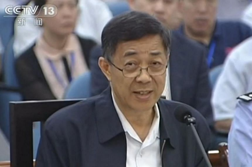 This screengrab taken from state television CCTV footage broadcast on Aug 24, 2013, shows ousted Chinese political star Bo Xilai (centre) speaking in the courtroom as he stands trial at the Intermediate People's Court in Jinan, in eastern China's Sha