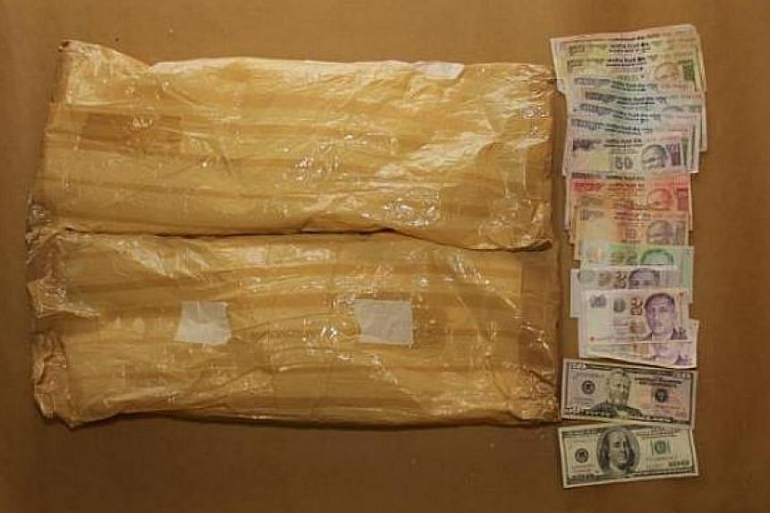 Items seized in the CNB operation on Aug 23, 2013. -- PHOTO: CENTRAL NARCOTICS BUREAU