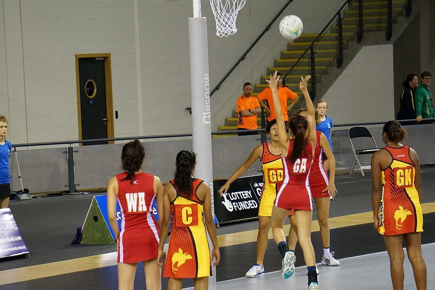 Singapore shooters Melissa Teo and Jocelyn Ng in action against Papua New Guinea at the World Youth Netball Championship in Scotland.Singapore's 21-and-Under netball team started their campaign in Glasgow brightly, beating Papua New Guinea 54-3