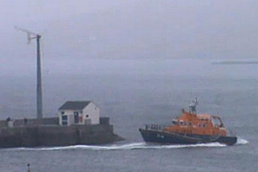 Video still issued by the RNLI of the Aith lifeboat responding to the helicopter that ditched in the sea off Shetland, Scotland, on Friday evening Aug 23, 2013. -- PHOTO: AP
