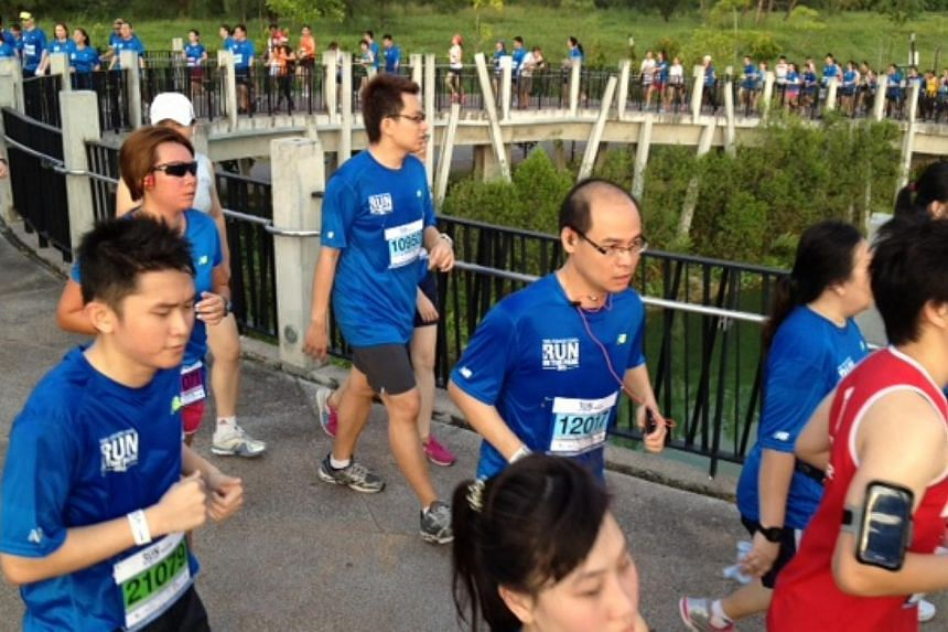 A mix of 10km and 15km runners on top of the sunrise bridge at Punggol Waterway at The Straits Times Run In The Park 2013. -- ST PHOTO: SEAH KWANG PENG