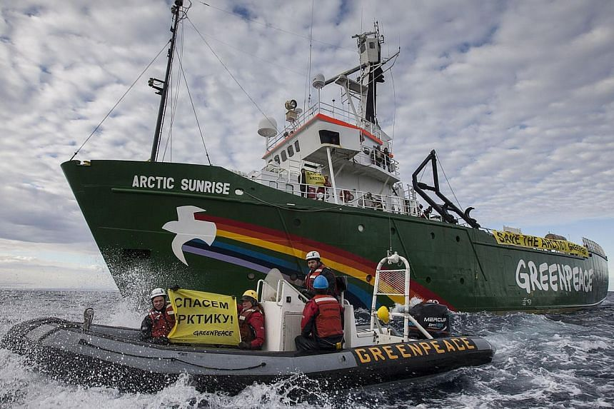 A handout photo released by Greenpeace shows the Greenpeace ship Arctic Sunrise entering the Northern Sea Route (NSR) off Russia's coastline to protest against Arctic oil drilling on Aug 24, 2013. Greenpeace has deployed its icebreaker through an Arc