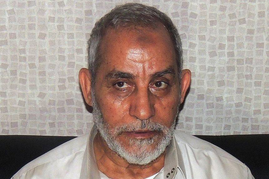 The trial of Egyptian Muslim Brotherhood chief Mohamed Badie (above) and two deputies on charges of inciting the murder of protesters was adjourned minutes after it opened on Sunday because the defendants were absent.-- FILE PHOTO: AFP