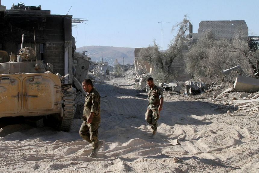 Syrian army soldiers are seen deployed in the Jobar neighbourhood of Damascus, Syria on Aug 24, 2013. Damascus on Sunday, Aug 25, 2013, gave the green light for United Nations inspectors to carry out an immediate probe into allegations of chemical we