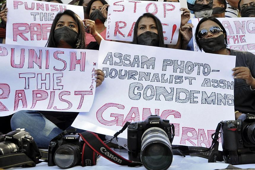 Members of the All Assam Photojournalists Association wear black sashes around their mouths, during a protest against the rape of a photo journalist by five men inside an abandoned textile mill in Mumbai, in the north-eastern Indian city of Guwahati