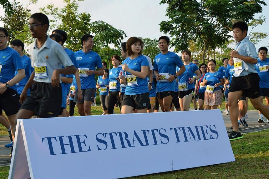 More than 12,000 runners completed the inaugural The Straits Times Run in the Park at Punggol Waterway Park on Sunday morning. -- ST PHOTO: PAUL CHEONG