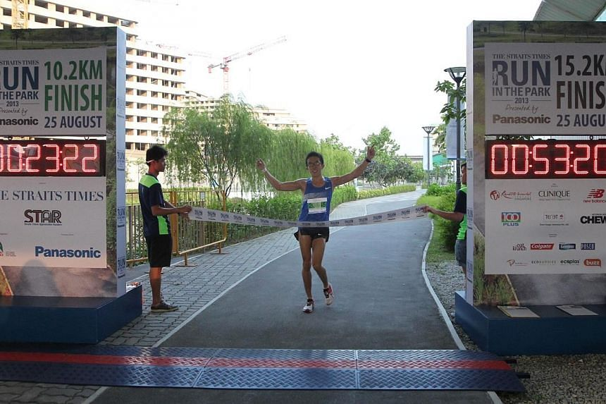Ivan Low, 28, winner of the 15km (Men) category at The Straits Times' Run in the Park held at Punggol Waterway on Aug 25, 2013. -- ST PHOTO: NEO XIAOBIN