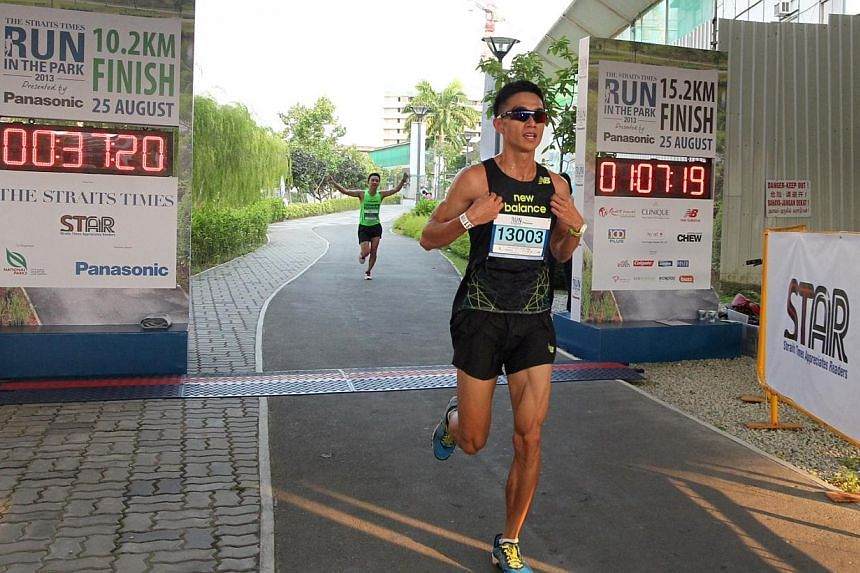 Fang Jian Yong, 23, winner of the 10km (Men) category at The Straits Times' Run in the Park held at Punggol Waterway on Aug 25, 2013. -- ST PHOTO: NEO XIAOBIN