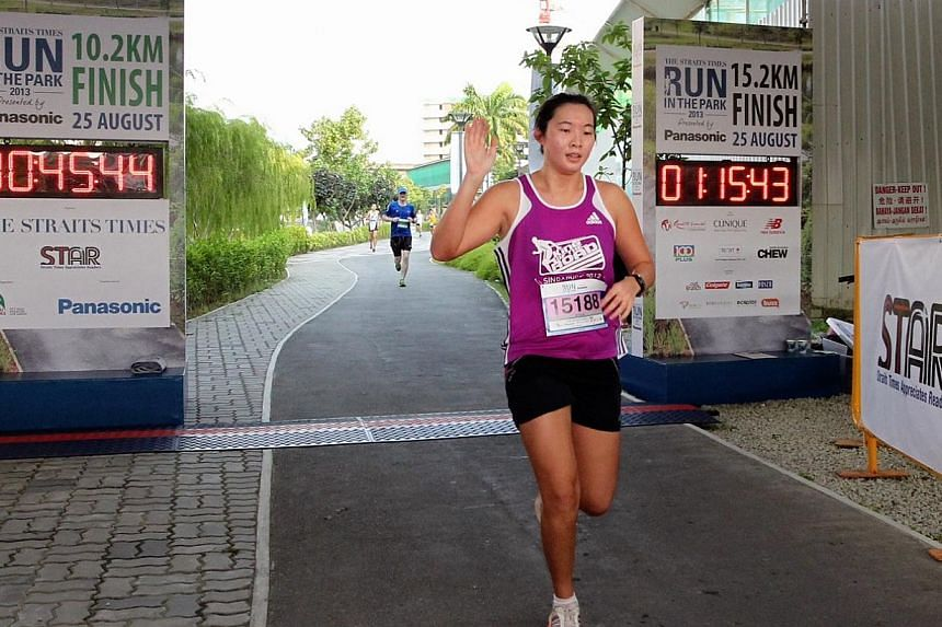 Clara Wong, winner of the 10km (Women) category at The Straits Times' Run in the Park held at Punggol Waterway on Aug 25, 2013. -- ST PHOTO: NEO XIAOBIN