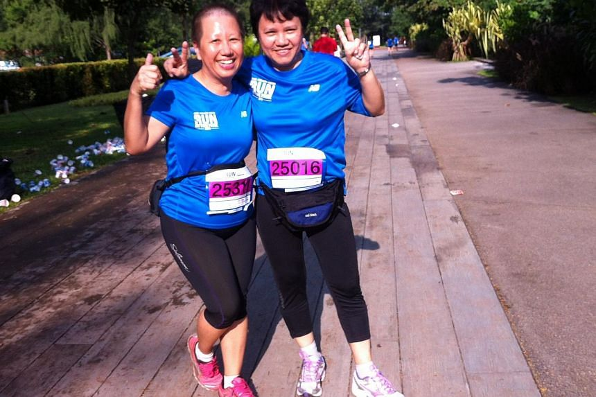 HR manager Mona Ee, 53, and her friend Annie Cheng, a 53-year-old admin assistant, at Punggol Point Park, the last 3km of their 15km run. Said Mona, 'It's our first time taking part in a 15 km run. We are enjoying the run and the scenery here!' -- ST