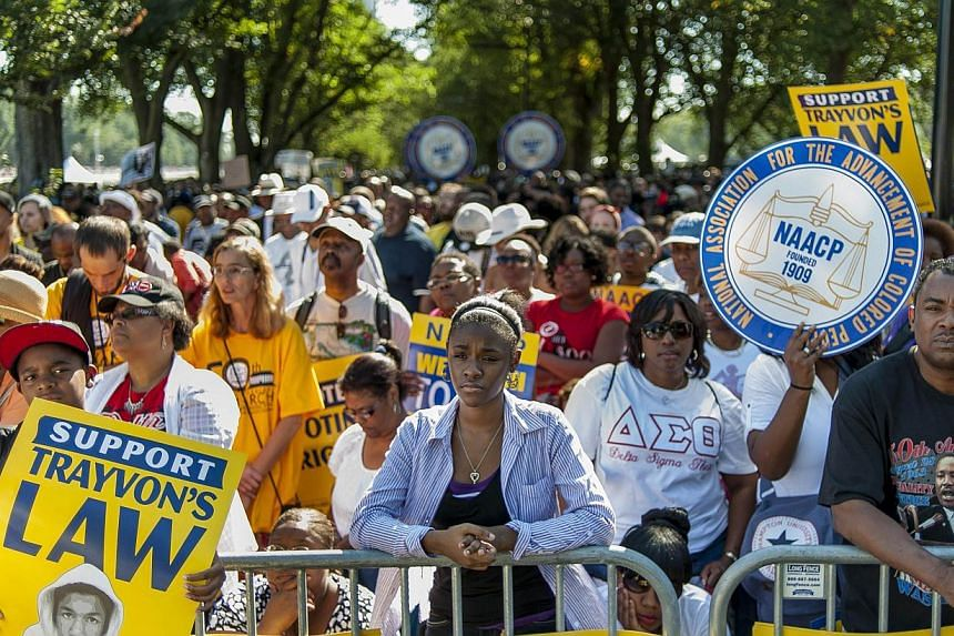 People arrive at the National Mall to celebrate the 50th anniversary of the March on Washington and Dr Martin Luther King, Jr's 'I have a Dream' speech on the National Mall on Aug 24, 2013 in Washington, DC. -- PHOTO: AFP