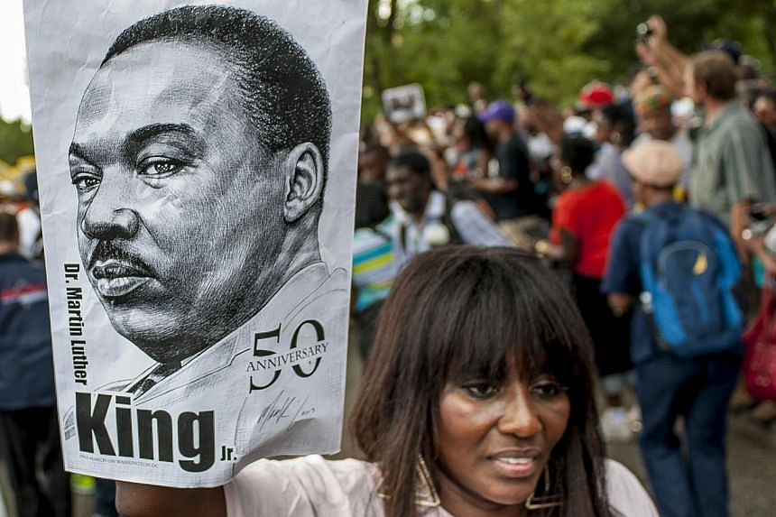 People arrive at the National Mall to celebrate the 50th anniversary of the March on Washington and Dr. Martin Luther King, Jr's 'I have a Dream' speech on the National Mall on Aug 24, 2013 in Washington, DC. A commemorative march and a rally along t