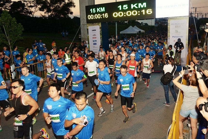 Flag off for the 15km run at 6.45am.  -- ST PHOTO: DESMOND WEE