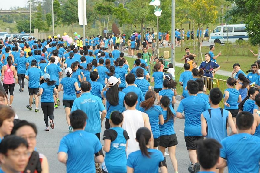 Runners at the starting point of 10km race, which started at 7.15am on Sunday, Aug 25, 2013.  -- ST PHOTO: DESMOND WEE