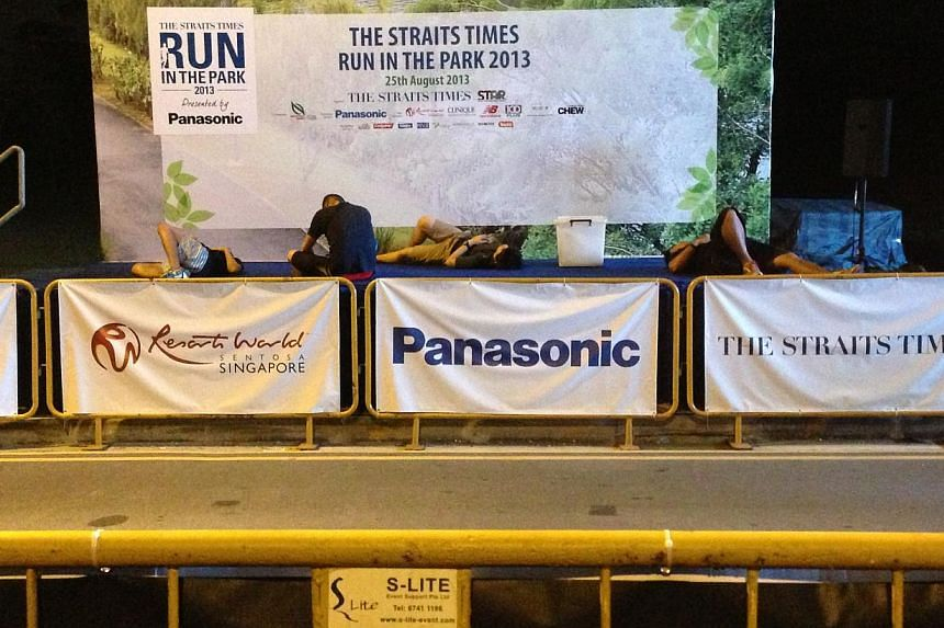 People taking a nap before the start of the first race. -- ST PHOTO: ALPHONSUS CHERN