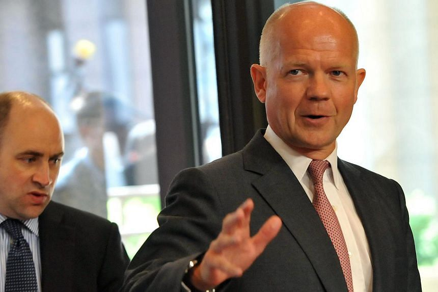British Foreign Secretary William Hague gestures as he arrives for an extraordinary EU Foreign Affairs Council on August 21, 2013 at the European Headquarters. Mr Hague said on Sunday that any evidence of a chemical attack by the Syrian regime may ha