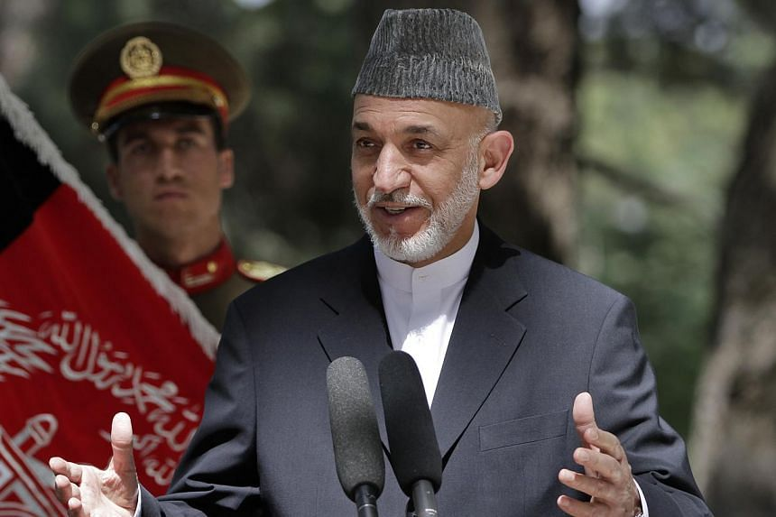 Afghan President Hamid Karzai speaks during a joint press conference with Italian Prime Minister Enrico Letta (unseen), at the Presidential palace in Kabul, Afghanistan, on Sunday, Aug 25, 2013. Mr Karzai is to hold key talks with Pakistan's newly el