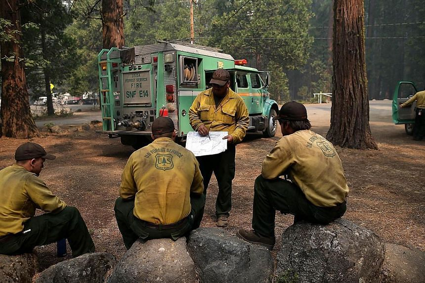 US Forest Service firefighters take a break from battling the Rim Fire at Camp Mather on Aug 25, 2013 near Groveland, California. The Rim Fire continues to burn out of control and threatens 4,500 homes outside of Yosemite National Park. Over 2,000 fi