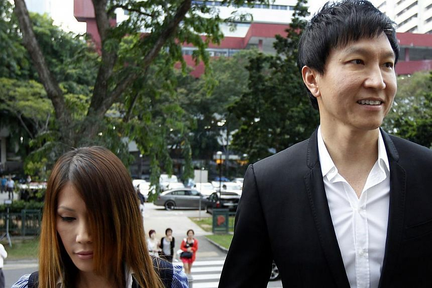 Kong Hee, founder of City Harvest Church, arrives at the Subordinate Courts with wife Ho Yeow Sun. He and five other leaders of the church are accused of embezzling more than $50 million from their parish to fund the secular pop music career of his w