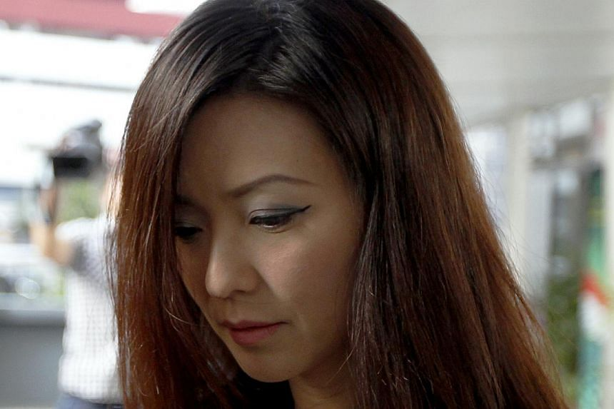 City Harvest Church's former finance manager Serina Wee arrives at the Subordinate Courts on Monday, Aug 26, 2013. She and five other leaders of the church, including founder Kong Hee, are accused of embezzling more than $50 million from their parish