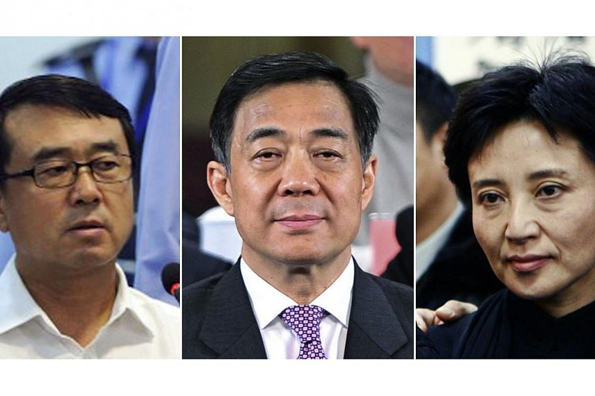 """Fallen Chinese politician Bo Xilai (centre) told his trial on Monday that the """"real reason"""" his police chief Wang Lijun (rigth)fled to a US consulate, in an incident that exposed a lurid corruption scandal, was because he was unmasked as being"""